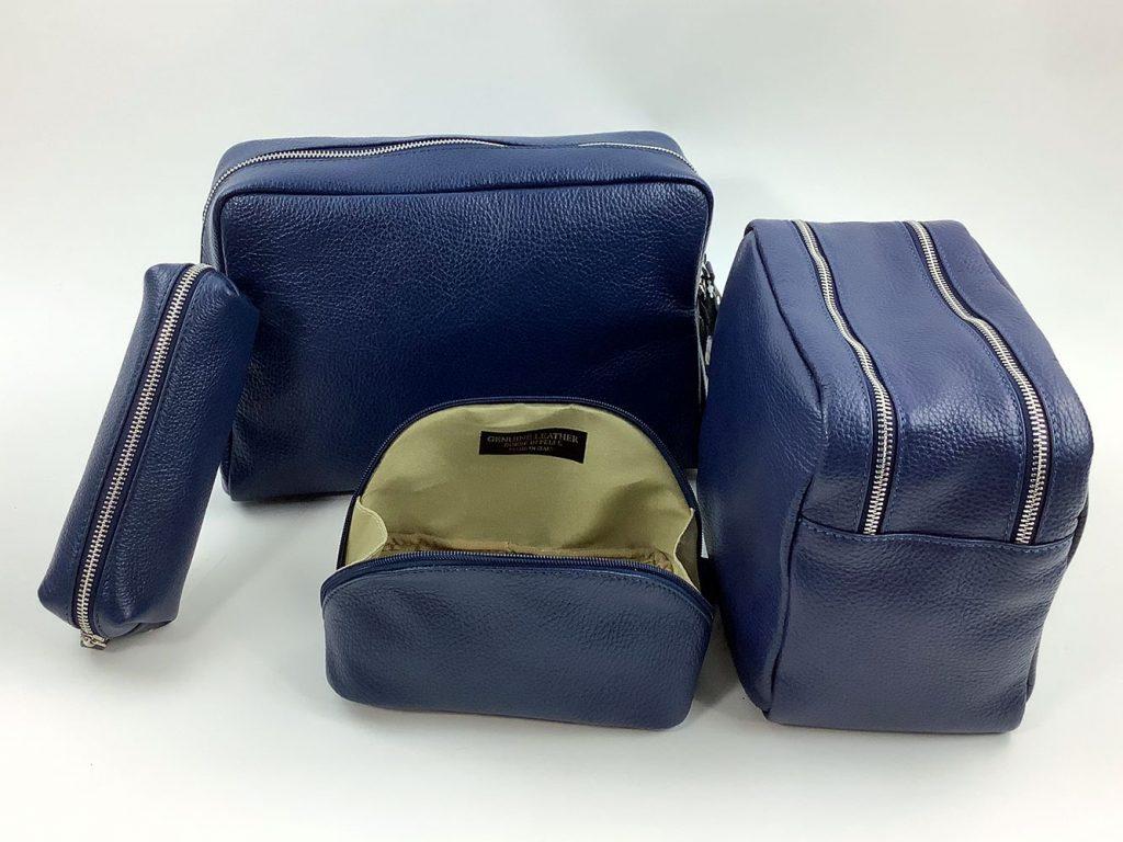 Kosmetiktaschen aus marineblauem Glattleder - München Süd Sommerkollektion 2020